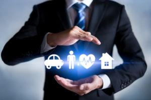 Businessman Holding Digital Insurance Concept