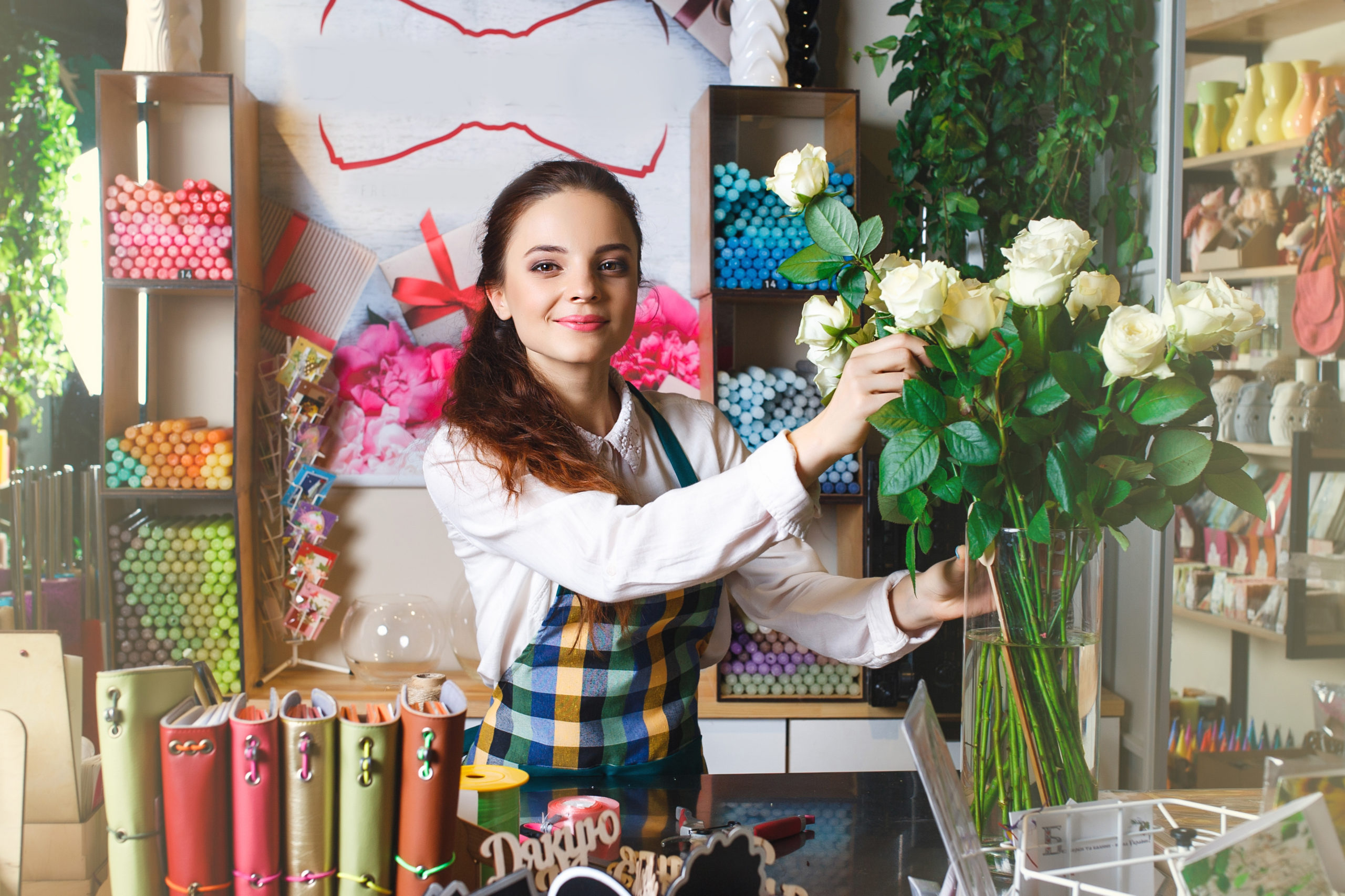 Florist Arranging Flowers In Shop