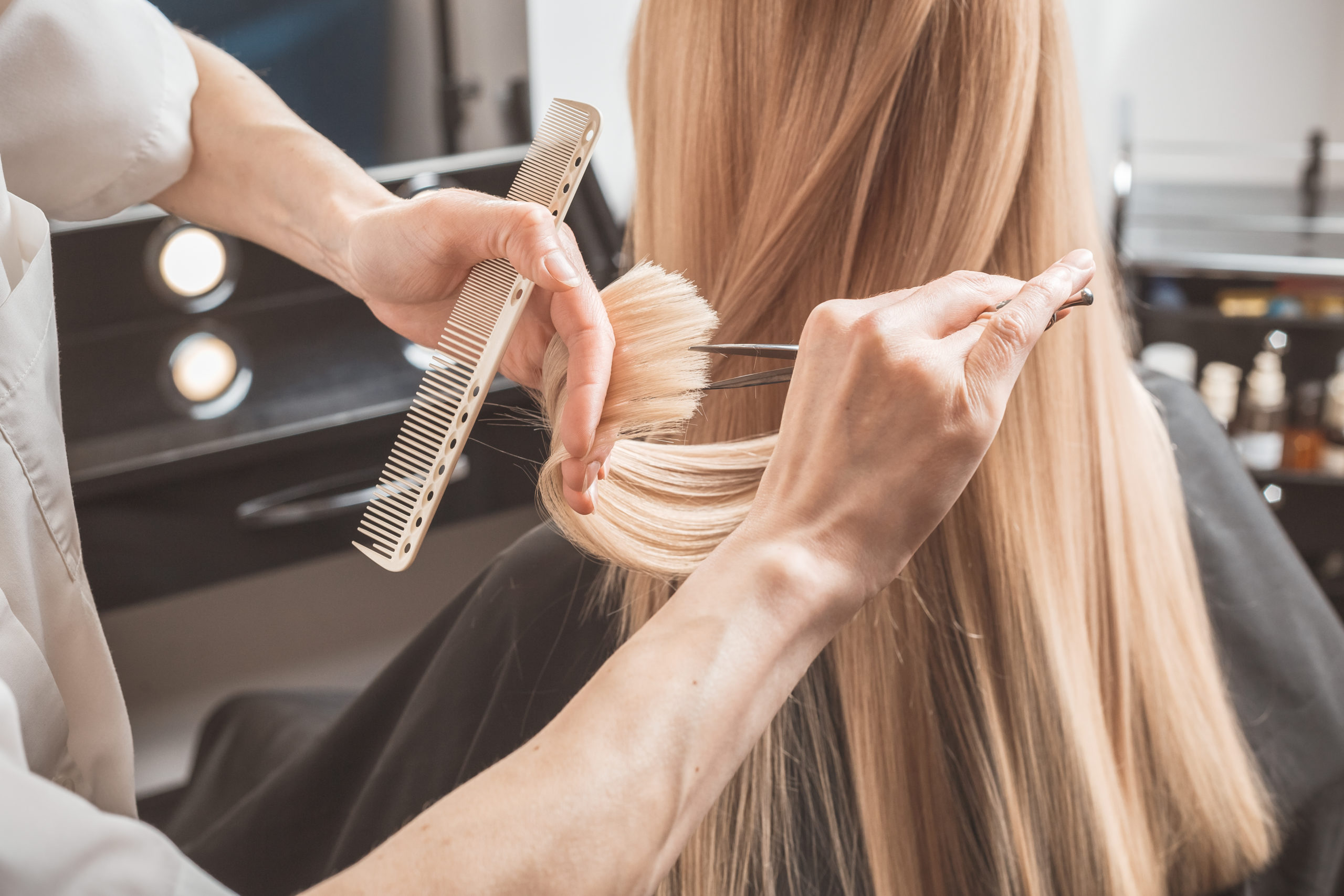 Hairdresser Cutting Long Blonde Hair