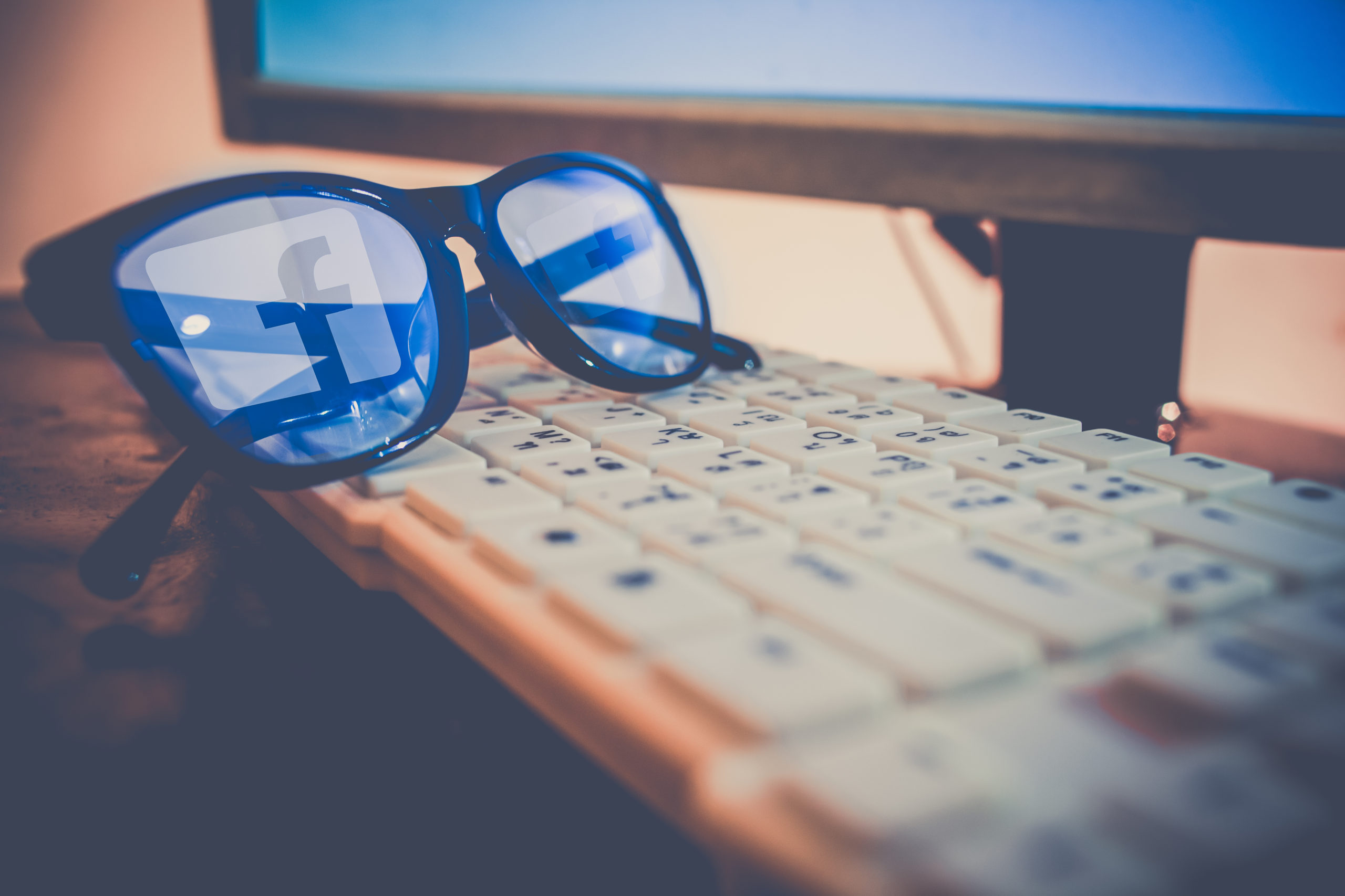 Facebook Logo Reflecting On Glasses