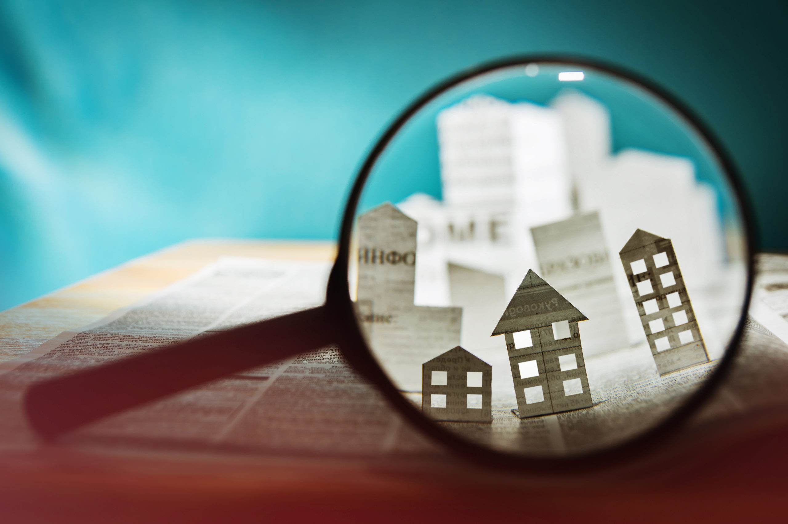 Paper House Under Magnifying Glass