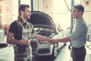 Motor Engineer Shaking Customer Hand