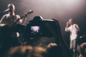 Photographer Taking Photo Of Band
