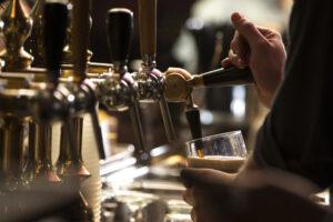Man Pulling Beer In Pub