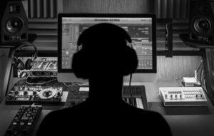 Man Producing Music In Studio