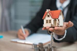 Man Holding Keys & House