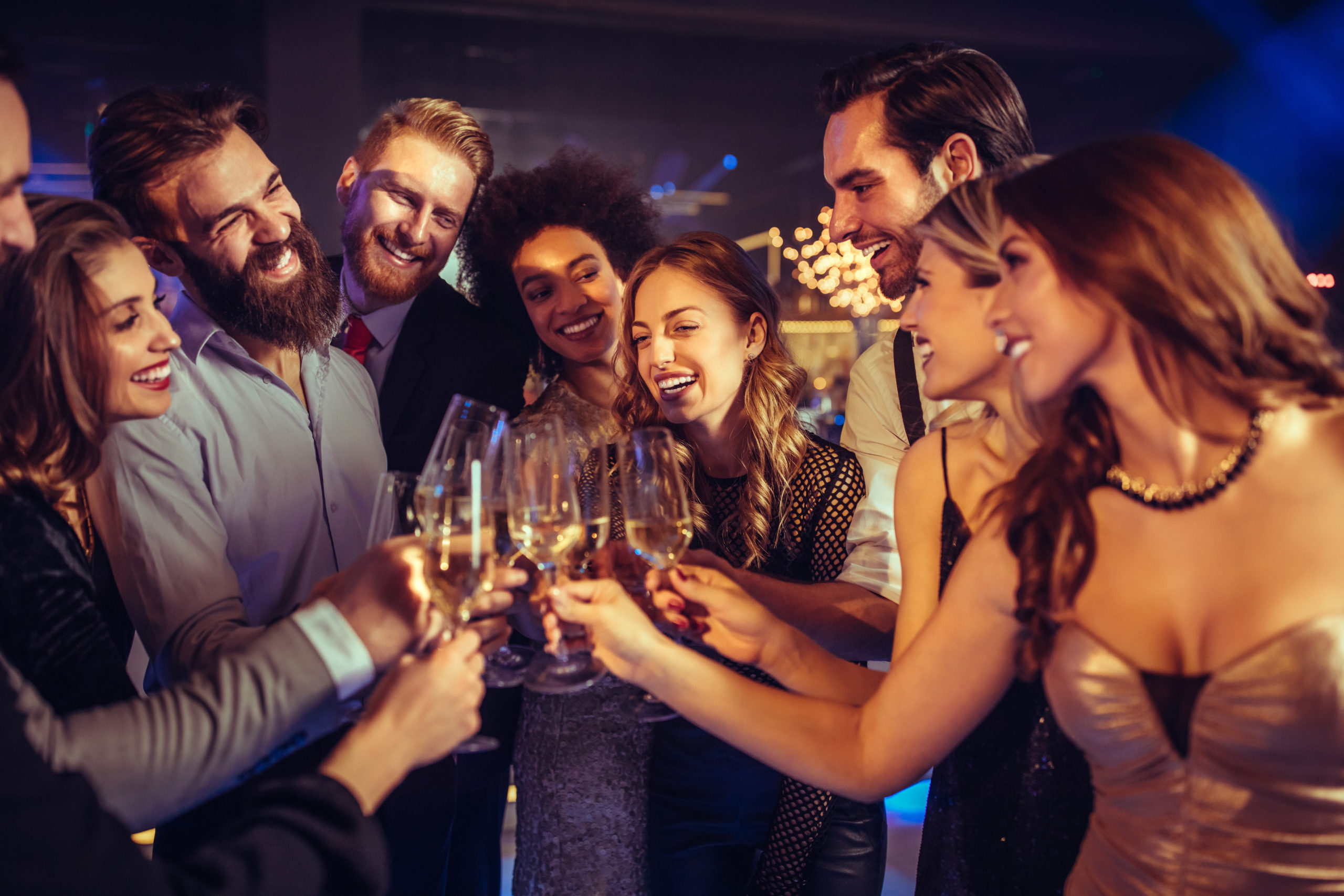 Group Of People Toasting Glasses
