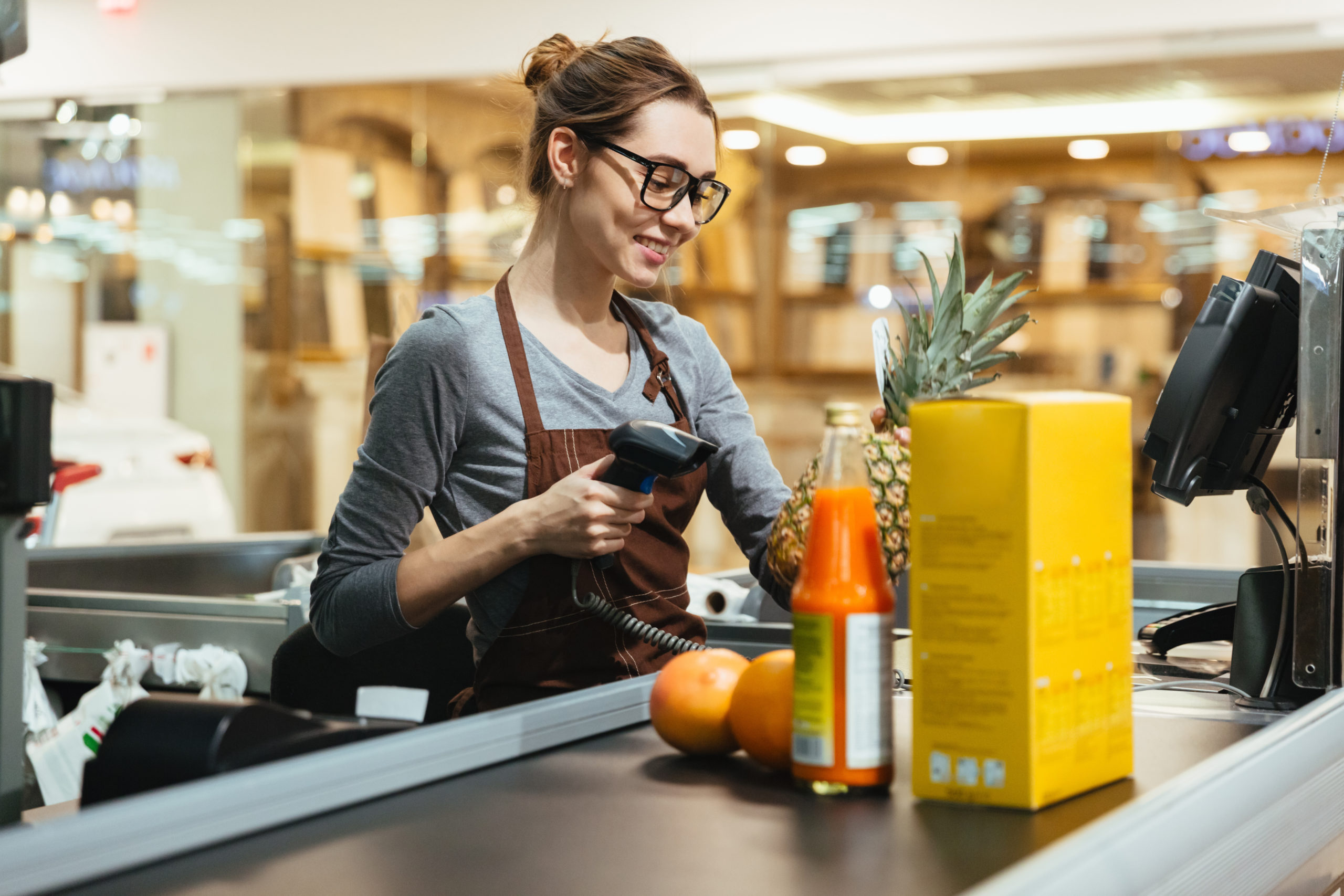 Cashier Scanning Grocery Items