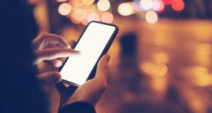 Man Using Smartphone At Night