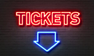Neon Sign Stating Tickets