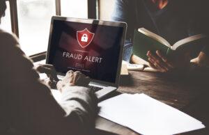 Fraud Alert Caution On Laptop
