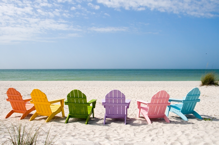 Colourful Deck Chairs on Beach