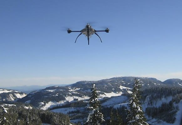 UAV Flying Over Snowy Mountain