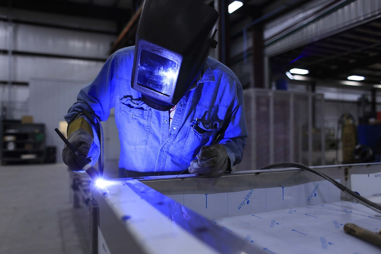 Engineer Welding in Workshop