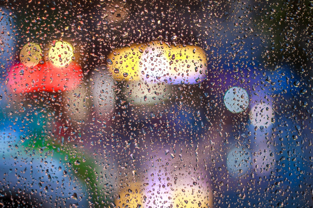 Rainy Window With Bright Lights