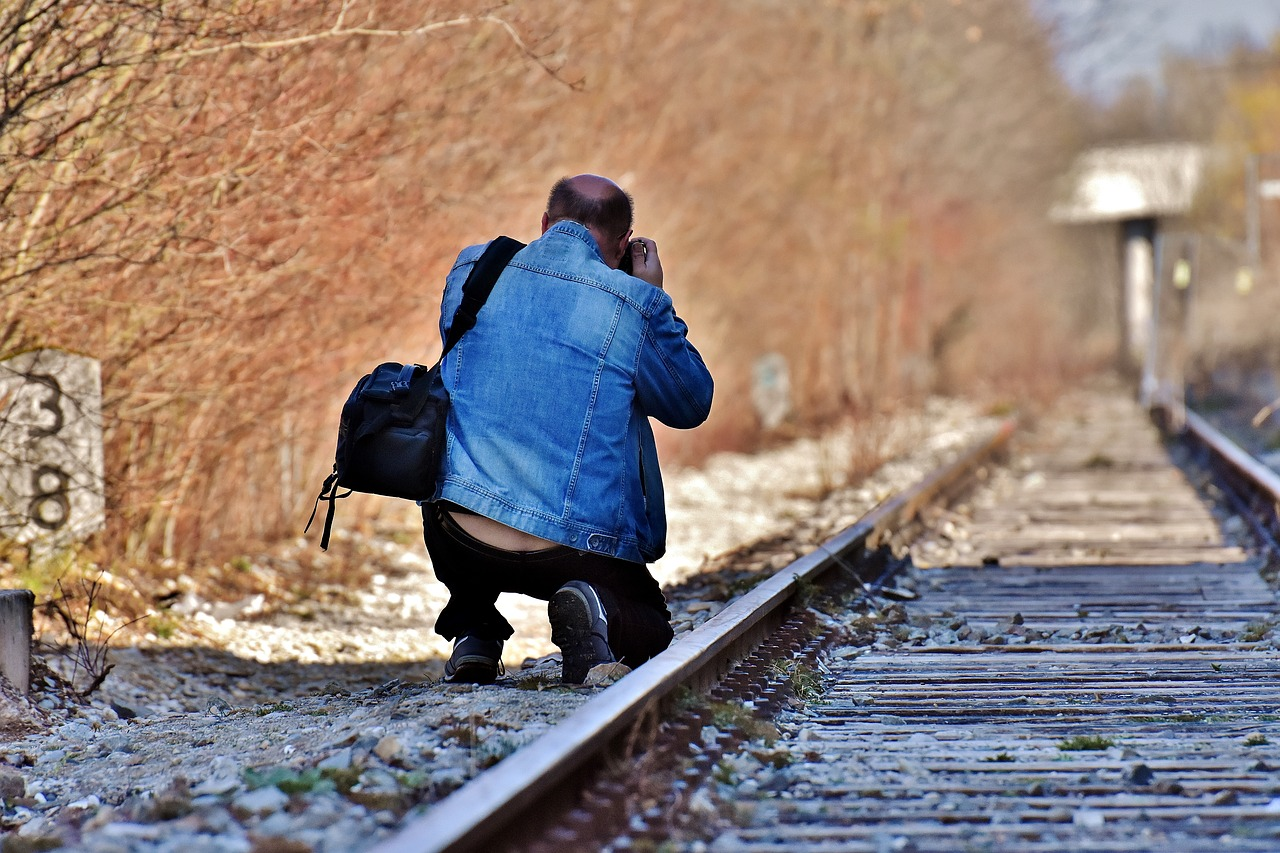 Photographer Photographing Train Track