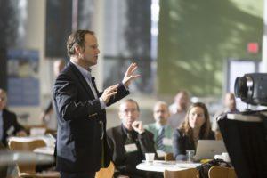 Training Consultant Speaking In Group