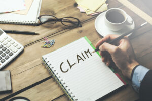 'Claim' Written On Notepad