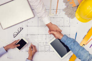 Architects Working With Blue Prints