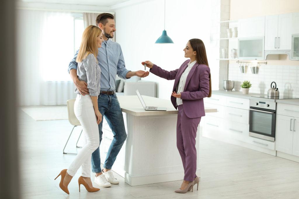Estate Agent Handing Keys Over